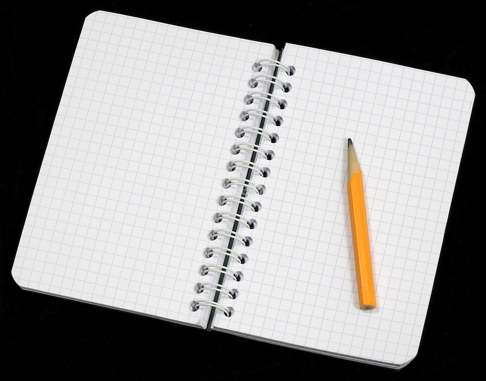 open notebook with pencil