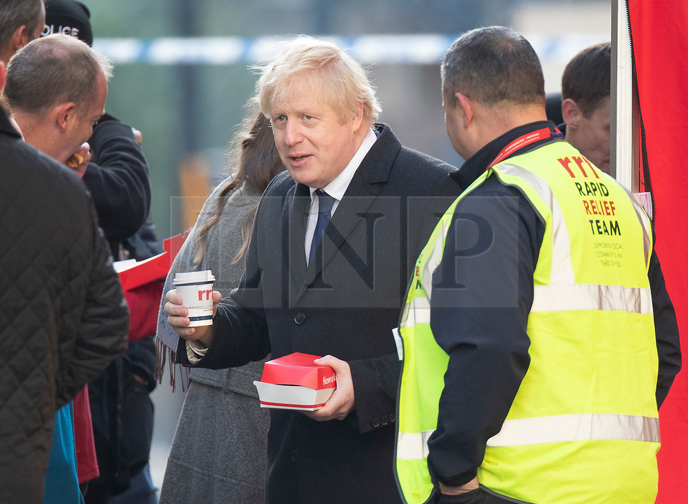 © Licensed to London News Pictures. 30/11/2019. London, UK. Prime Minister Boris Johnson purchases a hot drink and sandwich from a volunteer Rapid Relief Team catering tent  stationed near London Bridge the day after a terrorist attack. Two people were killed and three injured after the attacker, named by police as 28-year-old Usman Khan stabbed a man and a woman to death on London Bridge. Photo credit: Peter Macdiarmid/LNP