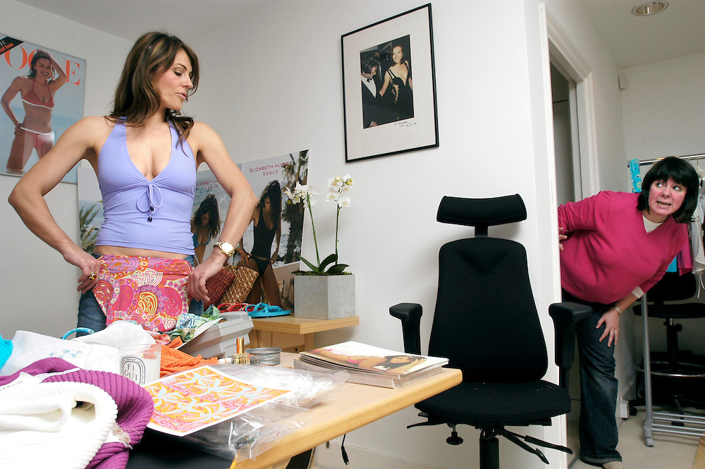 Elizabeth Hurley with her swimwear designs in her studio in South Kensington, London, UK.