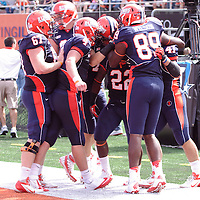 Illinois celebrates a touchdown by RB Dami Ayoola #22 at  Memorial Stadium, Champaign, Illinois, September 15, 2012. George Strohl/AI Wire.