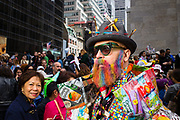 New York, NY - 21 April 2019. A man with a hat bristling with artist's paintbrushes at the Easter Bonnet Parade and Festival on New York's Fifth Avenue.