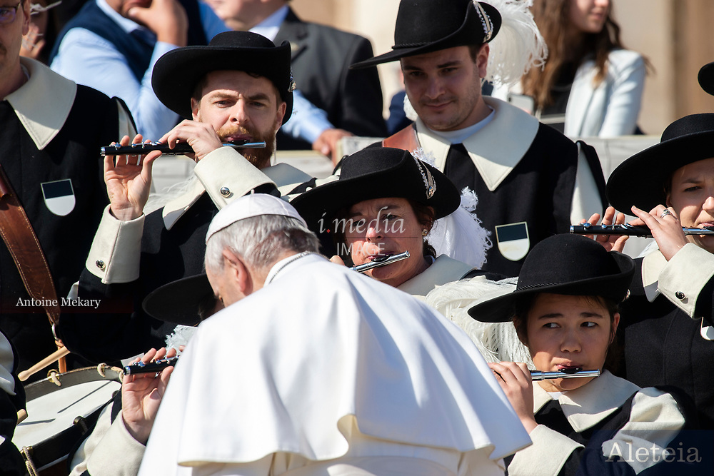 """Vatican City - MARCH 06, 2019: Members of the Fribourg-based Swiss Society of Fife and Drums """"La Bertholdia"""" plays for Pope Francis at the end of his weekly general audience in St. Peter's Square at the Vatican."""