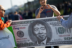 May 3, 2019 - Seattle, Washington, USA - Supporters of Democratic U.S. presidential candidate Andrew Yang, take a photos of a sign at a campaign rally at Gasworks Park in Seattle, Washington on May 3, 2019. Yang proposes giving every American 18 years and older, $1,000 every month as part of a universal basic income if he's elected. (Credit Image: © Karen Ducey/ZUMA Wire)