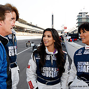 29 May 2010: Model/Actress Kim Kardashian, mother Kris Jenner, Former racecar driver Arie Luyendyk and racecar driver Arie Luyendyk, Jr.  prepare to take a couple laps around the infamous Indianapolis 500 Oval during the IZOD Two-Seat Ride Along session at the Indianapolis Motor Speedway in Speedway, IN..