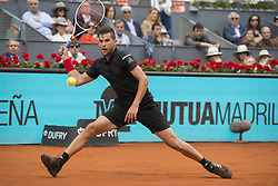 May 12, 2018 - Madrid, Madrid, Spain - DOMINIC THIEM reaches for the ball in a match against KEVIN ANDERSON during the semi finals of Mutua Madrid Open 2018 - ATP in Madrid. DOMINIC THIEM won the match 6-4 6-2. (Credit Image: © Patricia Rodrigues via ZUMA Wire)