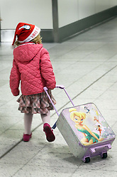A young child  at London Gatwick airport as the Christmas getaway starts Friday, 20th December 2013. Picture by Stephen Lock / i-Images