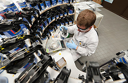 An AkzoNobel employee experiments with new mixtures of paint in the testing lab at the AkzoNobel paint production facility in Sassenheim, the Netherlands, Wednesday, Dec. 22, 2010. Akzo Nobel NV, the world's biggest paint maker, reported a 21 percent increase in third quarter net income to 238 million euros. (Photo © Jock Fistick)