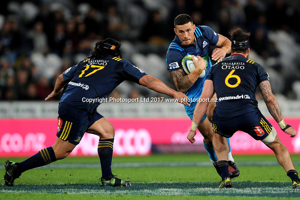 Sonny-Bill Williams of the Blues runs into contact, during the Super Rugby match between the Highlanders and the Blues, held at Forsyth Barr Stadium, Dunedin, New Zealand, on the 8th of April 2017. Credit: Joe Allison / www.Photosport.nz