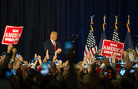 Donald J. Trump is greeted by the crowd at Laconia Middle School. (Karen Bobotas/for the Laconia Daily Sun)