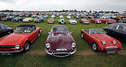 © Licensed to London News Pictures. 17/09/2011. GOODWOOD, UK. Rows of vintage cars in the carpark. The Goodwood Revival at Goodwood in West Sussex today (17 September 2011). The revival is the world's largest historic motor race meeting, which relieves the 'glorious' days of the race circuit. Competitors and enthusiasts all dress in period fashion to enhance the experience. Photo credit : Stephen Simpson/LNP