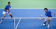 (L) Borna Coric & (R) Marin Draganja both of Croatia compete at men's double game during the BNP Paribas Davis Cup 2014 between Poland and Croatia at Torwar Hall in Warsaw on April 5, 2014.<br /> <br /> Poland, Warsaw, April 5, 2014<br /> <br /> Picture also available in RAW (NEF) or TIFF format on special request.<br /> <br /> For editorial use only. Any commercial or promotional use requires permission.<br /> <br /> Mandatory credit:<br /> Photo by © Adam Nurkiewicz / Mediasport