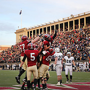 Andrew Fischer, Harvard, is hoisted by team mates who celebrate after Fischer caught a 35-yard touchdown pass from Conner Hempel for the winning touchdown with 55 seconds to play as Harvard beat Yale 31-24 to capture the Ivy League title outright during the Harvard Vs Yale, College Football, Ivy League deciding game, Harvard Stadium, Boston, Massachusetts, USA. 22nd November 2014. Photo Tim Clayton