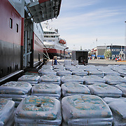 Goods waiting to be loaded at the portelone of the passenger ship Kong Harald. Three weeks aboard the Kong Harald. Hurtigruten, the Coastal Express. Bergen.