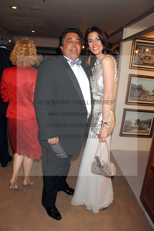 MR & MRS WALID JUFFALI she was Christina Estrada at the Grosvenor House Art & Antiques Fair Gala evening in aid of the UK