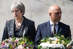 © Licensed to London News Pictures. 03/06/2018. London, UK. British Prime Minister THERESA MAY and Home Secretary SAJID JAVID mark a minutes silence for the victims of the 2017 London Bridge Terror attack, held on London Bridge. Eight people were killed and 48 were injured when a van was deliberately driven into pedestrians on London Bridge. Three occupants then ran to the nearby Borough Market area carrying knives and fake explosives. Photo credit: Ben Cawthra/LNP