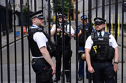 Armed police at the gates of Downing Street in central London after a meeting of the Government's emergency Cobra committee following last night's terrorist incident in London.