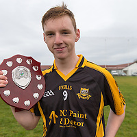 Captain Mark Crowe lifting the Minor B Shield