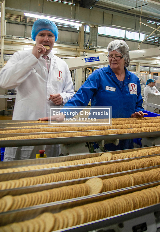 Pictured: Derek Mackay chats to Helen on the productiopn l.ine<br /> <br /> Economy Secretary Derek Mackay visited Nairn's Oatcakes in Edinburgh today to comment on the latest export and GDP statistics. Mr Mackay enjoyed a short tour of the factory where staff demonstrated the manufacturing process.<br /> <br /> Ger Harley | EEm 30 January 2019