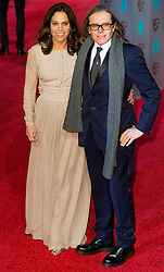 © Licensed to London News Pictures. 14/02/2016. London, UK. ELIZABETH KARLSEN and STEPHEN WOOLEY arrive on the red carpet at the EE British Academy Film Awards 2016 Photo credit: Ray Tang/LNP