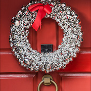 Silver Christmas Wreath with decorations on front door in Greenwich Village.<br />