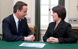 Leader of the Conservative Party David Cameron with Jane Ellison.Member of Parliament for Battersea in his office in Norman Shaw South, January 5, 2010. Photo By Andrew Parsons / i-Images.