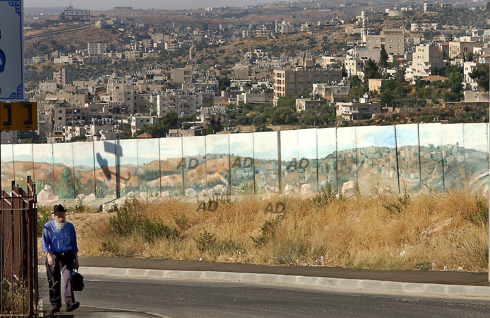 The wall to protect Gilo settlers from sniper who shot from the opposite hill Betlhem.