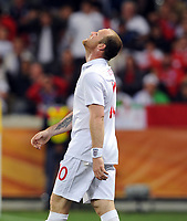 A Dejected Wayne Rooney<br /> England World Cup 2010<br /> England V Algeria (0-0) 18/06/10 Group C at Durban<br /> FIFA World Cup 2010<br /> Photo Robin Parker Fotosports International