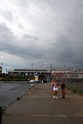 Atmospheric conditions at Coney Island cause Beach goers to saty off beach with Police to arrest any attempting to swim in the rough waters of NYC area beaches on August 21, 2009..Huricane Bill forced the close of several NYC beaches which include Rockaway Beach, Coney Island Beach, Manhattan Beach, South Beach, Midland Beach and Wolfe's Pond Beach to swimming due to the approaching hurricane. Orchard Beach in the Bronx remains open assuming conditions do not deteriorate