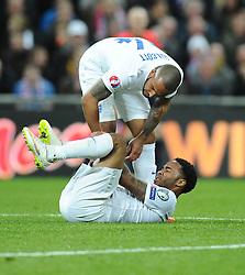 Raheem Sterling of England (Liverpool) goes down injured  - Photo mandatory by-line: Joe Meredith/JMP - Mobile: 07966 386802 - 27/03/2015 - SPORT - Football - London - Wembley Stadium - England v Lithuania - UEFA EURO 2016 Qualifier