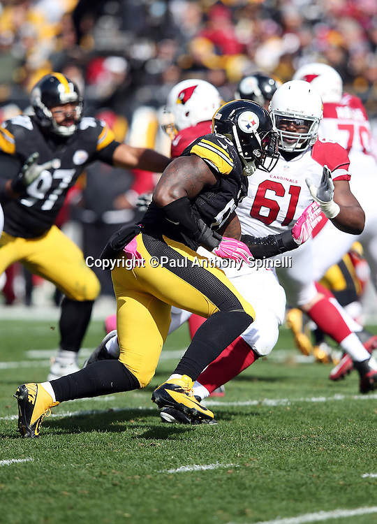 Pittsburgh Steelers outside linebacker Arthur Moats (55) gets blocked by Arizona Cardinals guard Jonathan Cooper (61) as he rushes the quarterback during the 2015 NFL week 6 regular season football game against the Arizona Cardinals on Sunday, Oct. 18, 2015 in Pittsburgh. The Steelers won the game 25-13. (©Paul Anthony Spinelli)