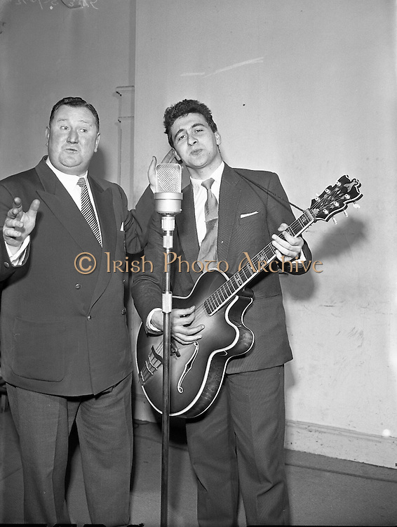 "Willie Brady (with guitar) in Take the Floor.11/04/1957..1950s and 60s Willie Brady had been a recording artist for Avoca Records in the U.S.A. and Ireland, was one of the first Irish artists to revive and popularize the singing of Irish songs and ballads at this time. He was frequently to be heard on Radio Eireann..Din Joe or Denis Fitzgibbon a comedian and compere of RTE's ""Take the Floor"""