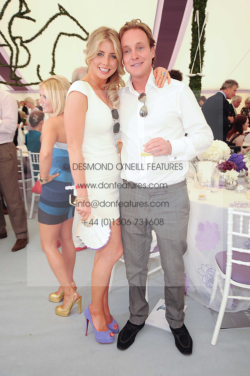 PIERS BECKWITH and     at the Cartier International Polo at Guards Polo Club, Windsor Great Park, Berkshire on 25th July 2010.