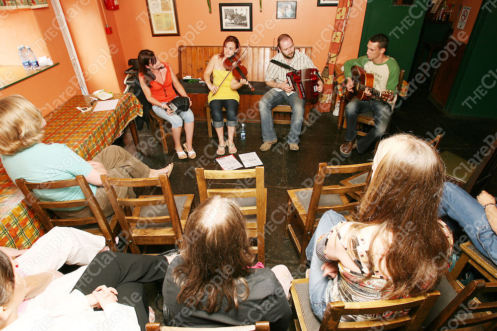 Peppers bar, Feakle. Having an afternoon lunchtime trad session. Pictured are the musicians TReresa O'Dea (concertina), Carmel O'Dea (fiddle), Derek Hickey (accordian) & Noel Ryan (Guitar) entertaining the crowd. Pic. Emma Jervis/ press 22