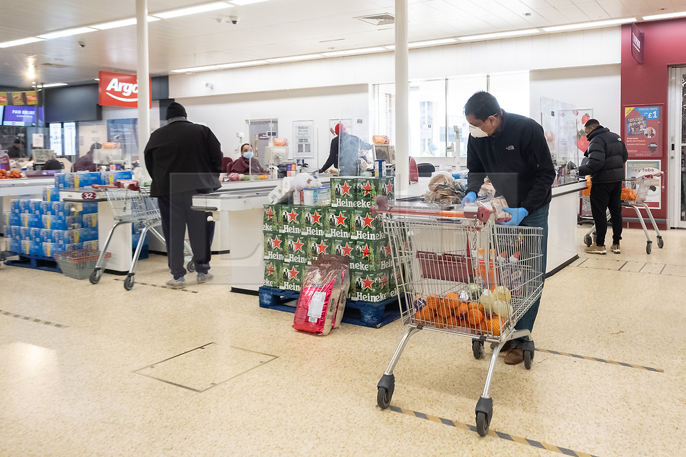 © Licensed to London News Pictures. 29/03/2020. London, UK. People observe social distancing measures as Sainsbury's supermarket introduce protective screens at checkouts due the the Coronavirus outbreak. Photo credit: London News Pictures