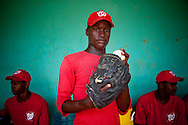 Sandy Perez, a 15-year-old pitcher for the Warriors baseball team, moved from the small town of Mata Mamon, several hundred kilometers away, to work with Juan Ignacio Hernandez Nodar for a chance to make the major leagues. He poses for a portrait on Thursday, February 25, 2010 in San Antonio de Guerra, Dominican Republic.