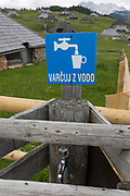 A fresh water tap near the collection of Slovenian herders' mountain huts in Velika Planina, on 26th June 2018, in Velika Planina, near Kamnik, Slovenia. Velika Planina is a mountain plateau in the Kamnik–Savinja Alps - a 5.8 square kilometres area 1,500 metres (4,900 feet) above sea level. Otherwise known as The Big Pasture Plateau, Velika Planina is a winter skiing destination and hiking route in summer. The herders' huts became popular in the early 1930s as holiday cabins (known as bajtarstvo) but these were were destroyed by the Germans during WW2 and rebuilt right afterwards by Vlasto Kopac in the summer of 1945.