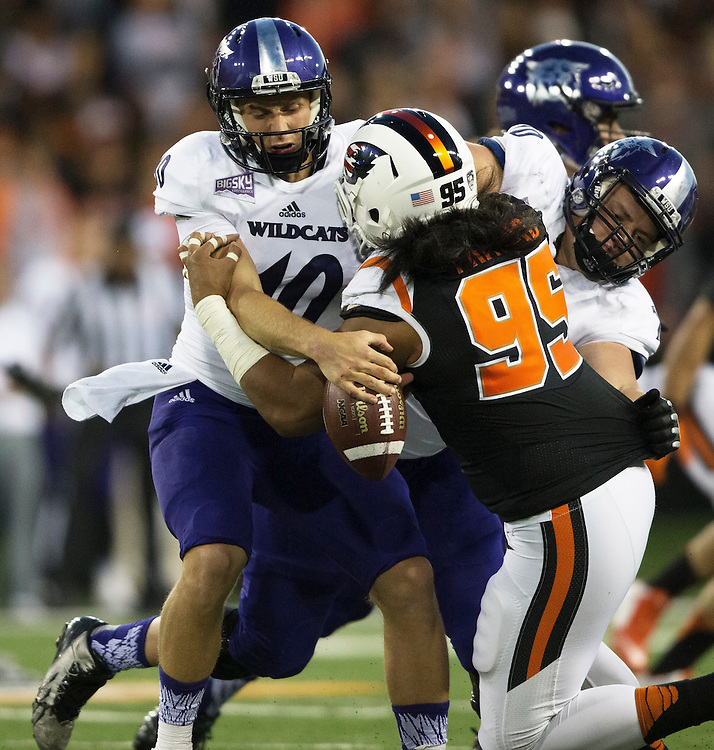 Weber State quarterback Jadrian Clark holds onto the ball while being sacked by Oregon State's Daker Pritchard during the Beavers' 26-7 victory in the 2015 season opener in Reser Stadium, in Corvallis, on Friday, Sept. 4, 2015.