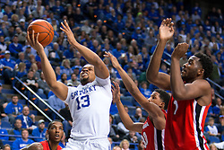 Kentucky guard Isaiah Briscoe, left, drives to the basket in the second half.<br /> <br /> The University of Kentucky hosted the University of Georgia, Tuesday, Feb. 09, 2016 at Rupp Arena in Lexington .