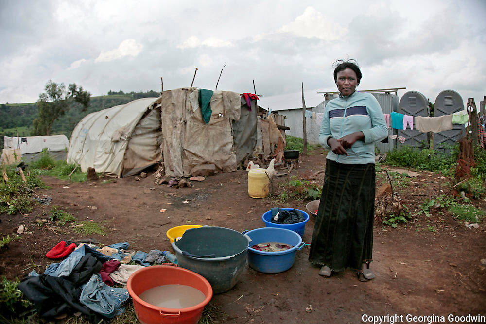 Washing clothes, cooking, just a few of the chores in a woman's work here done outside her makeshift tent home at Shalom City, a displaced peoples camp in Central Province Kenya. The camp held 14,000 people from the Kikuyu tribe displaced from various other areas from around Kenya, such as Kisumu and Eldoret and in particular the Rift Valley region, during the post-election violence that occurred after contested election results in Dec 2007/Jan 2008.