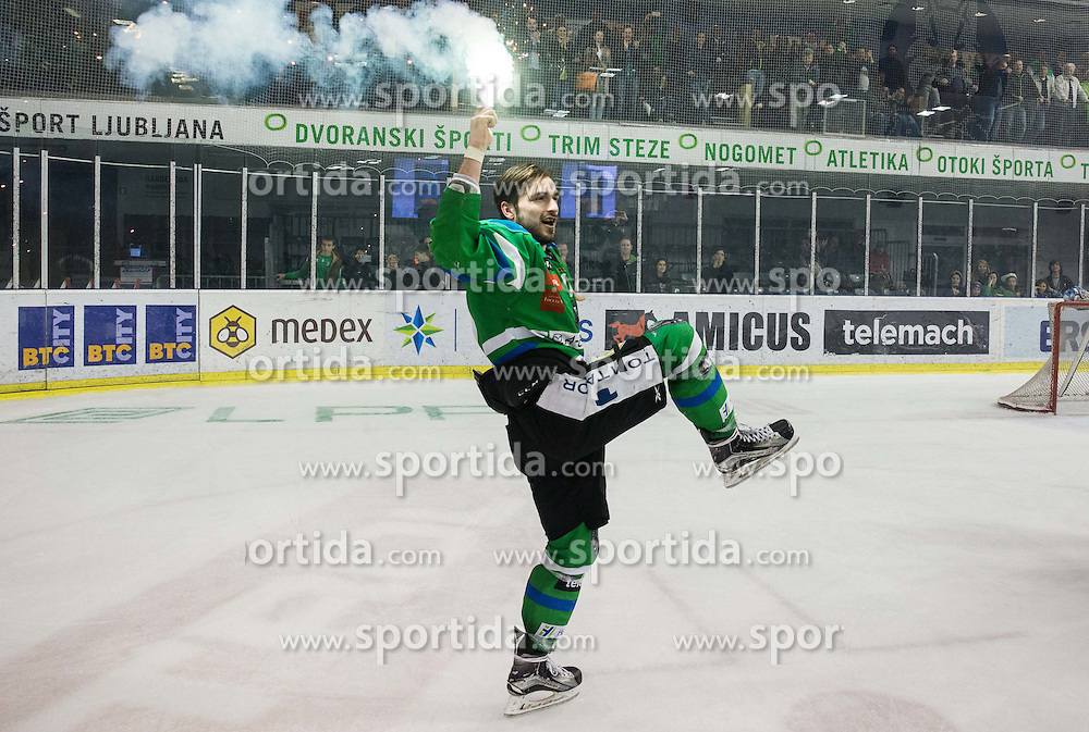 Ziga Pesut of Olimpija celebrates after they became Slovenian National Champion 2016 after winning during ice hockey match between HDD Telemach Olimpija and HDD SIJ Acroni Jesenice in Final of Slovenian League 2015/16, on April 11, 2016 in Hala Tivoli, Ljubljana, Slovenia. Photo by Vid Ponikvar / Sportida