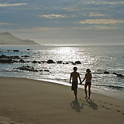 Couple walking on the beach. Cabo San Lucas, Mexico.