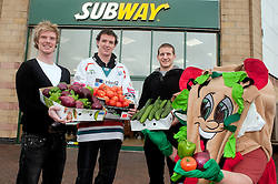 "Sheffield Steelers Geoff Woolhouse Mark Thomas and Jonathan Phillips with Subman and a range of the fresh salad items that make up a ""Healthier Way"" Sub outside the Centertainment Branch of Subway in Sheffield .26  October 2010 .Images © Paul David Drabble"