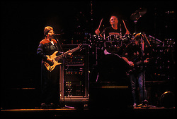 The Grateful Dead perfoming Just Like Tom Thumb's Blues at the Nassau Coliseum, Uniondale NY, 30 March 1990. Phil Lesh singing, Bill Kreutzmann and Bob Weir.