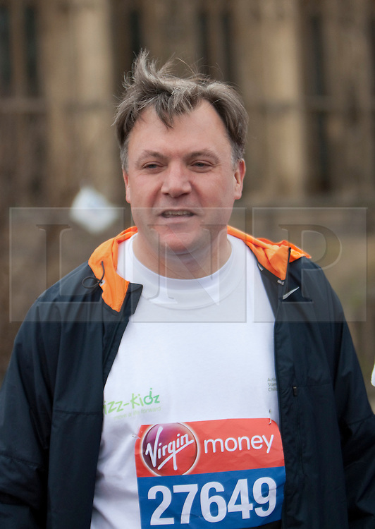 © Licensed to London News Pictures. 15/02/2012. London, U.K..Shadow Chancellor Ed Balls and MPs Edward Timpson, Alun Cairns, Graham Evans, Chris Kelly, Phillip Lee, and Jack Lopresti  in their running kit outside Parliament on Westminster Bridge ahead of Sunday's London Marathon..Photo credit : Rich Bowen/LNP