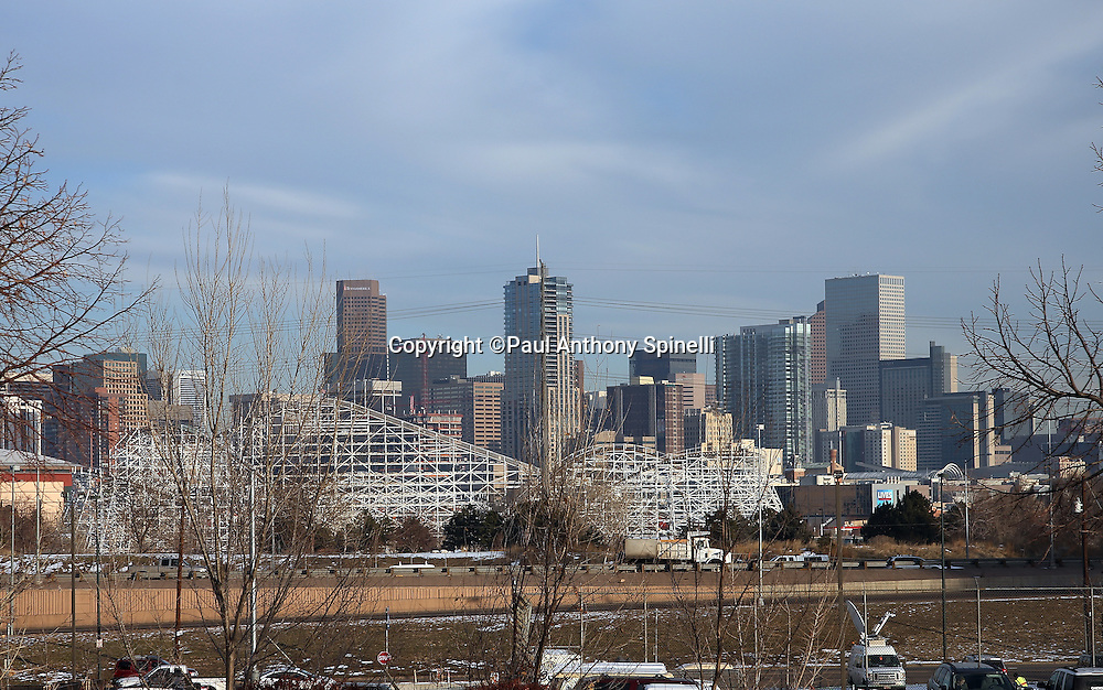The downtown Denver skyline is pictured in this wide angle, general view photograph taken before the Cincinnati Bengals 2015 NFL week 16 regular season football game against the Denver Broncos on Monday, Dec. 28, 2015 in Denver. (©Paul Anthony Spinelli)