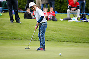 English golf professional Andy Sullivan gets a young fan to take his putt during the BMW PGA Championship Celebrity Pro-Am Day at the Wentworth Club, Virginia Water, United Kingdom on 25 May 2016. Photo by Simon Davies.
