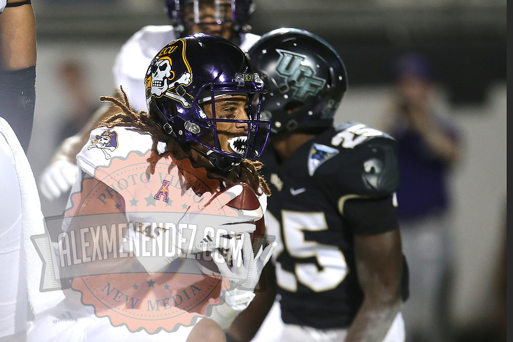 ORLANDO, FL - OCTOBER 14: Deondre Farrier #1 of the East Carolina Pirates celebrates his touchdown reception in front of Kyle Gibson #25 of the UCF Knights during a NCAA football game between the East Carolina Pirates and the UCF Knights at Spectrum Stadium on October 14, 2017 in Orlando, Florida. (Photo by Alex Menendez/Getty Images)