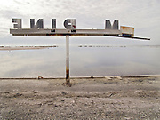 abandoned marina sign at the water edge