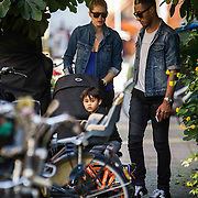 NLD/Amsterdam/20140902 - Doutzen Kroes with husband Sunnery James en kinderen wandelend