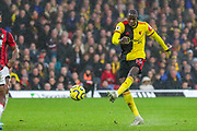 Watford midfielder Abdoulaye Doucouré (16) shoots towards the goal during the Premier League match between Watford and Bournemouth at Vicarage Road, Watford, England on 26 October 2019.